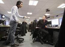 Traders work on a trading floor in London January 22, 2010. REUTERS/Stefan Wermuth