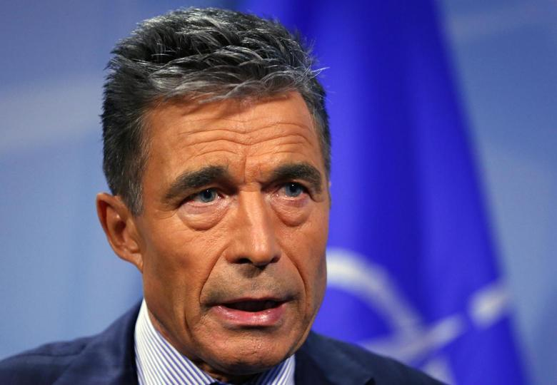 NATO Secretary General Anders Fogh Rasmussen speaks during an interview with Reuters at the Alliance headquarters in Brussels August 11, 2014.  REUTERS/Yves Herman