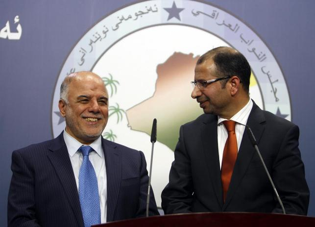 Salim al-Jabouri (R), speaker of the Iraqi Council of Representatives, and Haider Abadi (L), a member of Iraqi Prime Minister Nuri al-Maliki's State of Law bloc, attend a news conference in Baghdad, July 15, 2014. REUTERS/Ahmed Saad