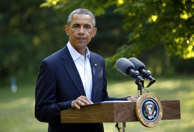 U.S. President Barack Obama delivers a statement on the situation in Iraq from his vacation home at Martha's Vineyard, Massachusetts August 11, 2014.     REUTERS/Kevin Lamarque
