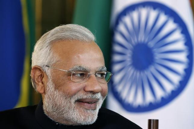 India's Prime Minister Narendra Modi reacts during a meeting with Brazil's President Dilma Rousseff (not pictured) on the sidelines of the 6th BRICS summit at the Alvorada Palace in Brasilia July 16, 2014. REUTERS/Ueslei Marcelino/Files