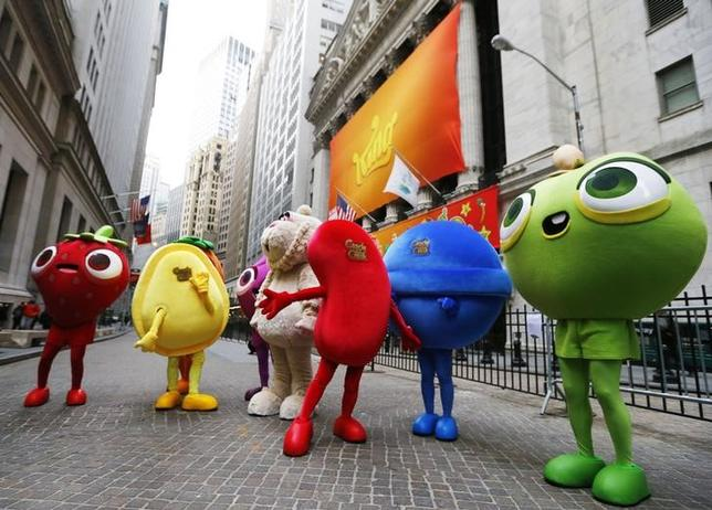 Mascots dressed as characters from the mobile video game ''Candy Crush Saga'' pose outside the New York Stock Exchange ahead of the IPO of Mobile game maker King Digital Entertainment Plc  March 26, 2014. REUTERS/Brendan McDermid/Files