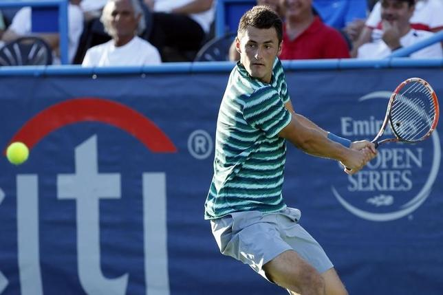 Jul 28, 2014; Washington, DC, USA; Bernard Tomic hits a backhand against Alejandro Gonzalez (not pictured) on day one of the Citi Open tennis tournament at the Fitzgerald Tennis Center.  Geoff Burke-USA TODAY Sports