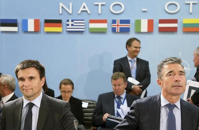 Ukraine's Foreign Minister Pavlo Klimkin and NATO Secretary General Anders Fogh Rasmussen (R) attend a NATO-Ukraine foreign ministers meeting at the Alliance headquarters in Brussels June 25, 2014. REUTERS/Francois Lenoir