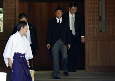 Japan PM sends offering to war dead shrine, angers...