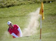 Brittany Lincicome of the U.S plays a bunker shot at the 11th hole during the women's British Open golf tournament at Royal Birkdale Golf Club, northern England, July 10, 2014. REUTERS/Nigel Roddis