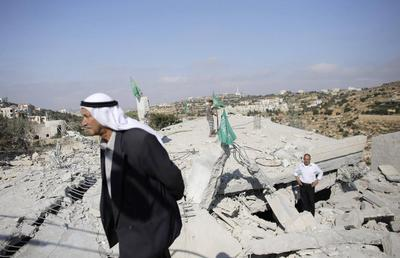 Israel destroys homes of Palestinians suspected of...