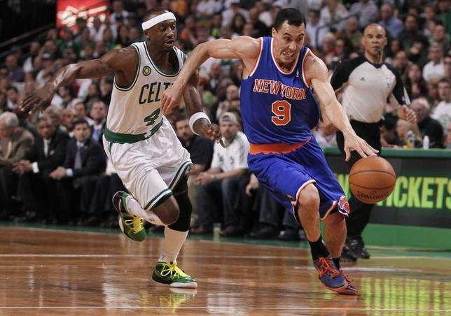 New York Knicks' Pablo Prigioni of Argentina drives past Boston Celtics' Jason Terry (L) during the first half of Game 3 of their NBA Eastern Conference semifinal playoff basketball series in Boston, Massachusetts April 26, 2013. REUTERS/Jessica Rinaldi