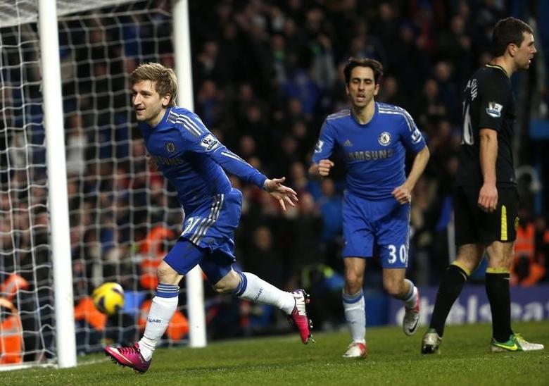 Chelsea's Marko Marin (L) celebrates his goal against Wigan Athletic during their English Premier League soccer match at Stamford Bridge in London February 9, 2013.   REUTERS/Eddie Keogh