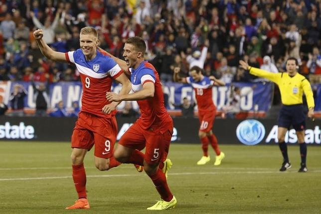 Aron Johannsson (9) of the U.S. is congratulated by teammate Matt Besler (5) after scoring a goal against Azerbaijan during an international friendly soccer match in San Francisco, California May 27, 2014. REUTERS/Stephen Lam