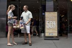 Shoppers are seen outside an Aeropostale store in Time Square in New York, July 27, 2012.  REUTERS/Andrew Burton