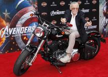 "Comic book creator and executive producer Stan Lee poses on a motorcycle at the world premiere of the film ""Marvel's The Avengers"" in Hollywood, California, in this April 11, 2012, file photo.  REUTERS/Danny Moloshok/Files"