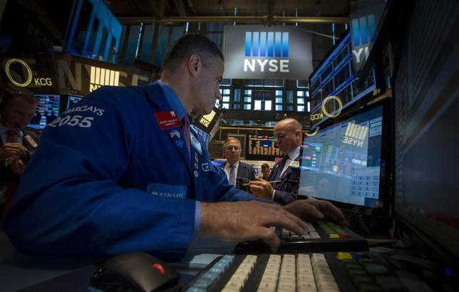 Traders work on the floor of the New York Stock Exchange August 20, 2014. REUTERS/Brendan McDermid