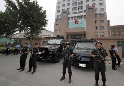 China tries five cult members for McDonald's murder
