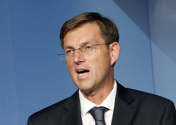 Miro Cerar (C), leader of the Stranka Mira Cerarja (Party of Miro Cerar), speaks at a news conference after parliamentary elections in Ljubljana July 13, 2014. REUTERS/Srdjan Zivulovic