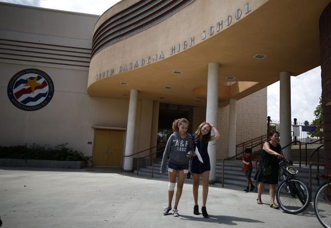 People walk out of South Pasadena High School in South Pasadena, California August 19, 2014. Police in the Los Angeles suburb of South Pasadena said on Monday they had thwarted a mass shooting plot with the arrest of two teenagers who were conspiring to kill several staffers and as many fellow students as possible at their high school. REUTERS/Lucy Nicholson