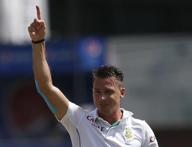 South Africa's Dale Steyn celebrates after taking the wicket of Sri Lanka's Kumar Sangakkara (not pictured) during the first day of their second test cricket match in Colombo July 24, 2014. REUTERS/Dinuka Liyanawatte