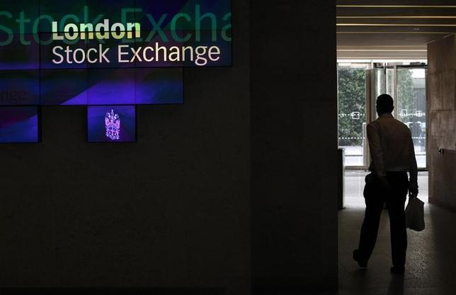 A man walks through the lobby of the London Stock Exchange August 5, 2011.REUTERS/Suzanne Plunkett