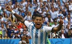 Rojo comemora gol da Argentina contra a Nigéria na Copa do Mundo em 25 de junho.      REUTERS/Stefano Rellandini