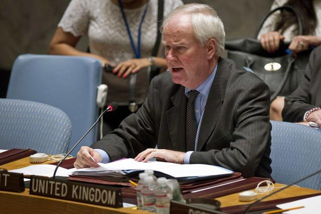 Britain's Ambassador to the U.N. Mark Justin Lyall Grant reads a statement following a United Nations Security Council vote on a resolution about the ongoing crisis in Iraq at United Nations headquarters in the Manhattan borough of New York August 15, 2014.  REUTERS/Carlo Allegri