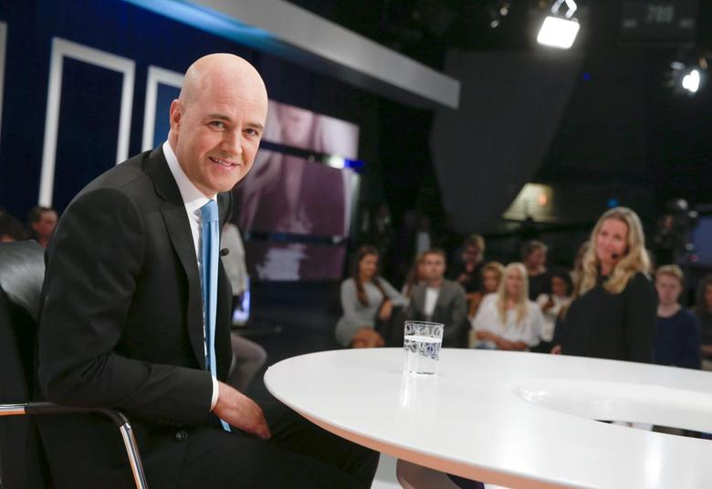 Sweden's Prime Minister Fredrik Reinfeldt of the Moderate Party poses in the studio during a break at his hearing in the Swedish broadcasting company SVT in Stockholm August 21, 2014. REUTERS/Fredrik Persson/TT News Agency