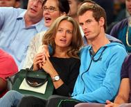 Aug 22, 2014; New York, NY, USA; Tennis star Andy Murray (right) talks with his girlfriend Kim Sears (left) during the fourth quarter of a game between the United States and Puerto Rico at Madison Square Garden. Brad Penner-USA TODAY Sports
