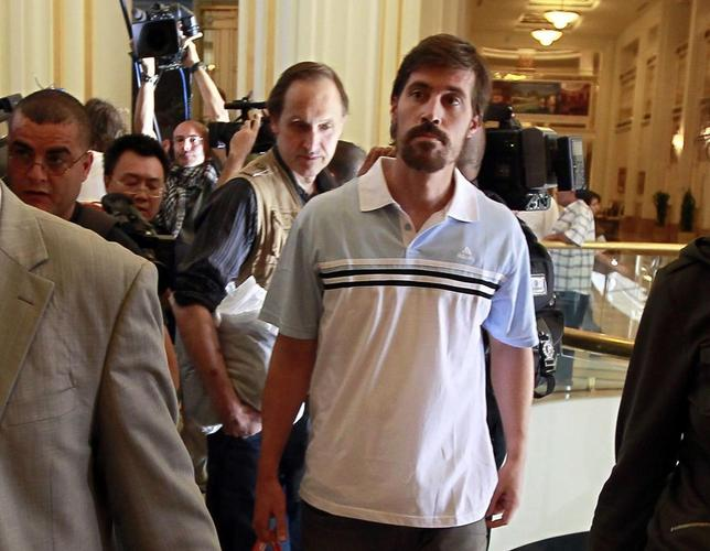 U.S. journalist James Foley (R) arrives with fellow reporter Clare Gillis (not pictured), after being released by the Libyan government, at Rixos hotel in Tripoli, in this picture taken May 18, 2011. REUTERS/Louafi Larbi/Files