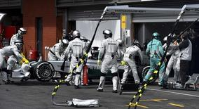 Mechanics push the car of Mercedes Formula One driver Lewis Hamilton of Britain in the pit after he retired from the Belgian F1 Grand Prix in Spa-Francorchamps August 24, 2014.  REUTERS/Ben Stansall/Pool