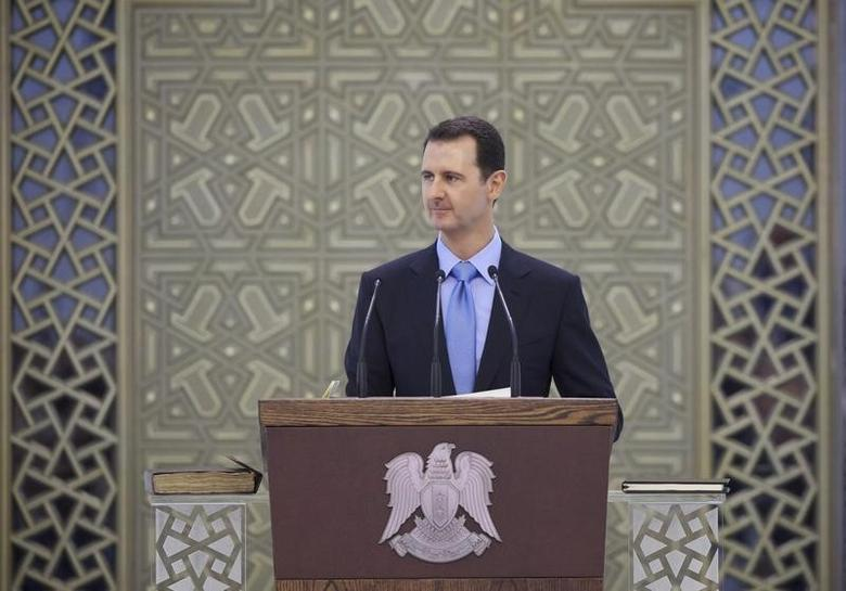 Syria's President Bashar al-Assad delivers a speech after being sworn in for a new seven-year term, at al-Shaab presidential palace in Damascus July 16, 2014, in this picture released by Syria's national news agency SANA.  REUTERS/SANA/Handout via Reuters