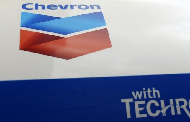 A Chevron gas station sign is pictured at one of their retain gas stations in Cardiff, California  October9, 2013.   REUTERS/Mike Blake