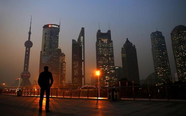 A man looks at the Pudong financial district of Shanghai November 20, 2013.   REUTERS/Carlos Barria