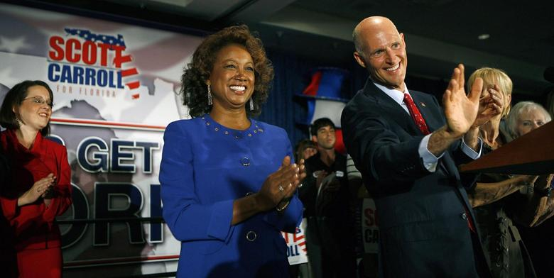 Former Florida Republican gubernatorial candidate Rick Scott (R) and running mate Jennifer Carroll (L) applaud the crowd at their victory rally in Ft. Lauderdale, Florida, in this file photo taken November 3, 2010.  REUTERS/Andrew Innerarity/Files