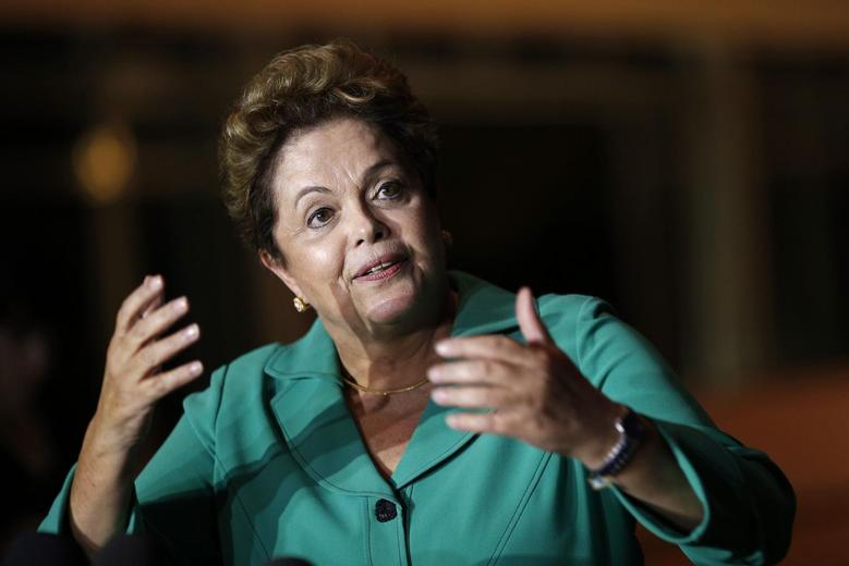 Brazil's President Dilma Rousseff reacts during a news conference at the Alvorada Palace in Brasilia August 25, 2014. REUTERS/Ueslei Marcelino