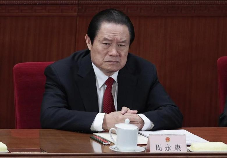 China's former Politburo Standing Committee Member Zhou Yongkang attends the closing ceremony of the National People's Congress (NPC) at the Great Hall of the People in Beijing March 14, 2012.  REUTERS/Jason Lee