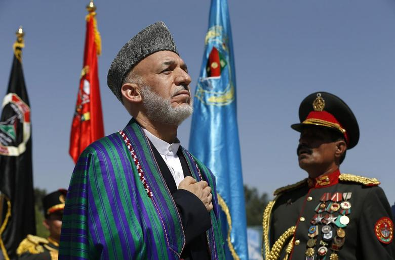 Afghan President Hamid Karzai (L) attends an event to commemorate Afghanistan's 95th anniversary of independence in Kabul August 19, 2014. REUTERS/Omar Sobhani