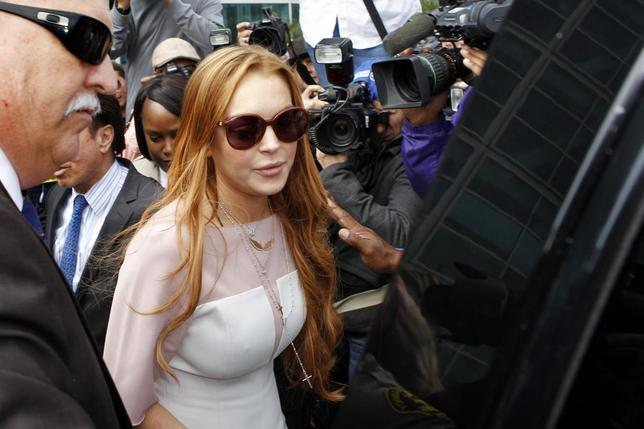 Actress Lindsay Lohan departs from court after a plea deal at the Airport Branch of the Los Angeles Superior Courthouse in Los Angeles, California in this file photo taken March 18, 2013.  REUTERS/Patrick T. Fallon/Files