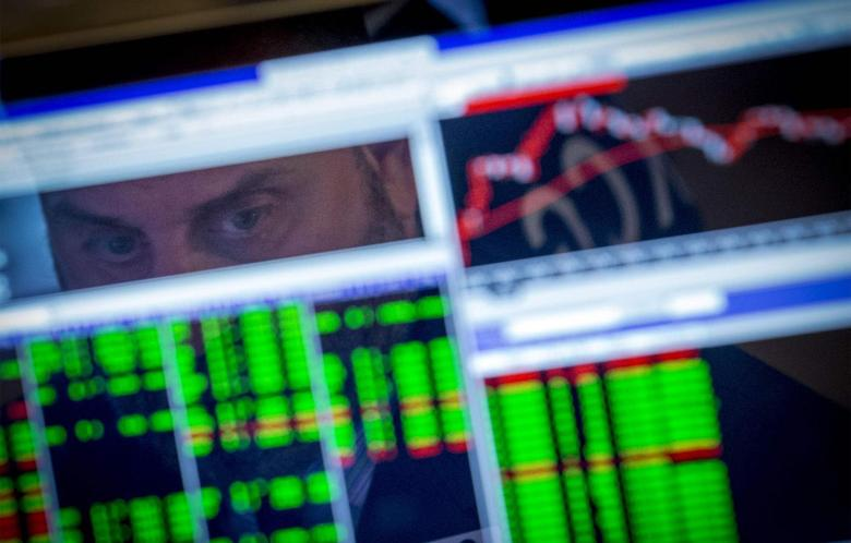 A specialist trader watches his screen on the floor of the New York Stock Exchange August 25, 2014. REUTERS/Brendan McDermid