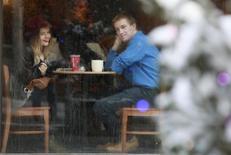 Кафе в Москве 21 января 2013 года. Российская ресторанная группа Росинтер в первой половине 2014 года получила прибыль впервые за последние более чем три года, заработав 57,4 миллиона рублей благодаря продаже непрофильных бизнесов, сообщила компания в четверг. REUTERS/Sergei Karpukhin