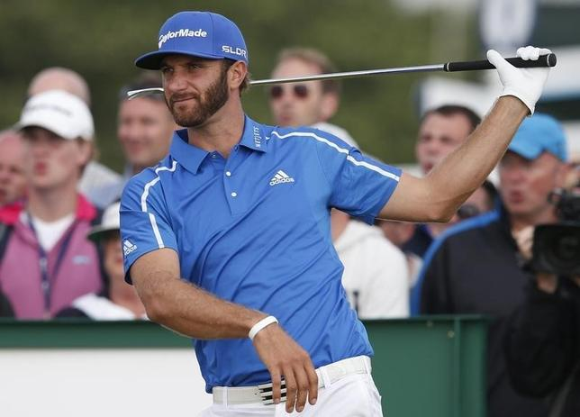 Dustin Johnson of the U.S. watches his tee shot on the 17th hole during the final round of the British Open Championship at the Royal Liverpool Golf Club in Hoylake, northern England July 20, 2014.  REUTERS/Cathal McNaughton