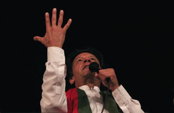 Imran Khan, the Chairman of the Pakistan Tehreek-e-Insaf (PTI) political party, addresses supporters in front of the Parliament house building during what has been dubbed a 'freedom march' in Islamabad August 28, 2014. REUTERS-Faisal Mahmood