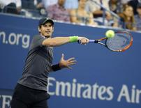 Andy Murray of Britain returns a volley to Matthias Bachinger of Germany during their men's singles match at the U.S. Open tennis tournament in New York, August 28, 2014.  REUTERS/Shannon Stapleton