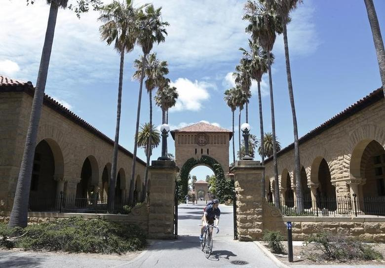 A cyclist exits the entryway to the Main Quad at Stanford University in Stanford, California, May 9, 2014.    REUTERS/Beck Diefenbach