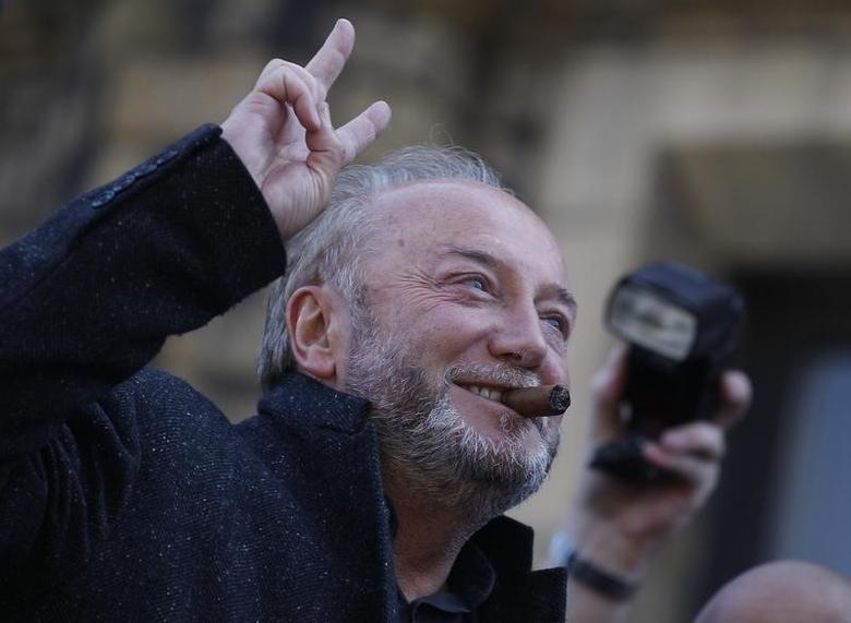 Respect Party candidate George Galloway gestures from an open top bus outside his campaign office in Bradford, northern England, March 30, 2012. REUTERS/Darren Staples