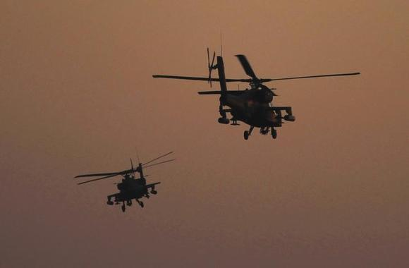 Apache helicopters fly over Tahrir Square during a protest to support the army, in Cairo July 26, 2013. REUTERS/Amr Abdallah Dalsh/Files