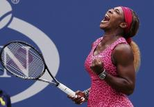 Serena Williams of the U.S. celebrates a point against compatriot Varvara Lepchenko during their match at the 2014 U.S. Open tennis tournament in New York, August 30, 2014.   REUTERS/Ray Stubblebine