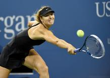Maria Sharapova (RUS) hits to Sabine Lisicki (GER) on day five of the 2014 U.S. Open tennis tournament at USTA Billie Jean King National Tennis Center. Mandatory Credit: Robert Deutsch-USA TODAY Sports