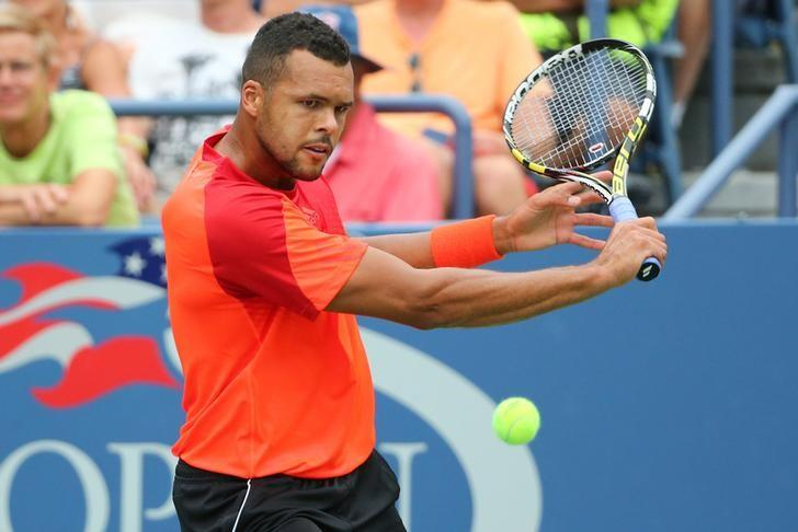 Aug 30, 2014; New York, NY, USA; Jo-Wilfried Tsonga (FRA) returns a shot to Pablo Carreno Busta (ESP) on the Grandstand Court on day six of the 2014 U.S. Open tennis tournament at USTA Billie Jean King National Tennis Center. REUTERS/Anthony Gruppuso-USA TODAY