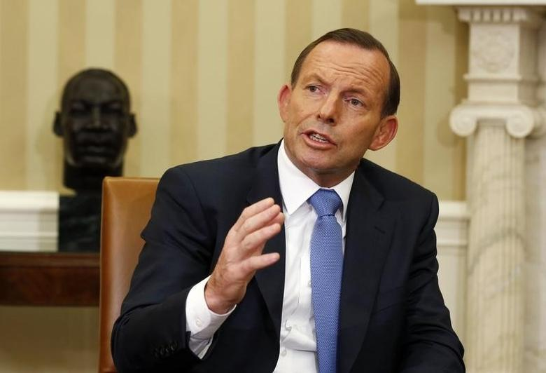 Australian Prime Minister Tony Abbott speaks in the Oval Office of the White House in Washington June 12, 2014.     REUTERS/Larry Downing