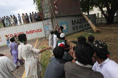 Pakistan parliament backs embattled prime minister as...