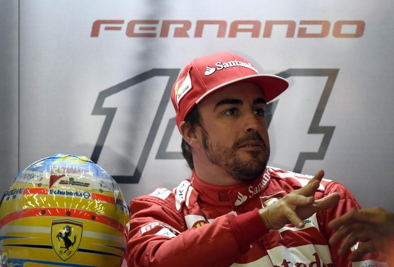 Ferrari Formula One driver Fernando Alonso of Spain react in the pit during a practice session ahead of the weekend's Belgian F1 Grand Prix in Spa-Francorchamps August 22, 2014.  REUTERS/Laurent Dubrule